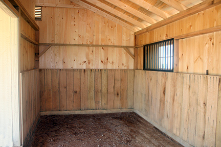 Inside Stall with Oak Kick Board in a Shed Row Horse Barn