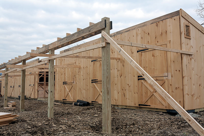 Construction: 12x80 Overhang Being Built on Shed Row Horse Barn