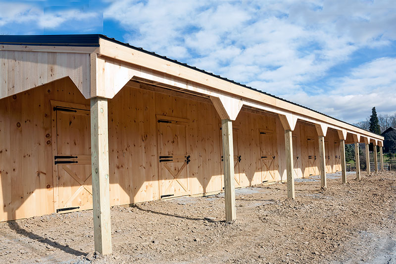 Construction:  Overhang Complete, Sections Together on Shed Row Horse Barn